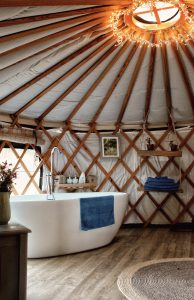 Luxury yurt ensuite bathroom with free standing bath tub at Pengelly Retreat