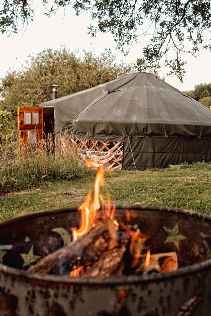 Cosy fire pit at the luxury lakeside yurt at Pengelly Retreat