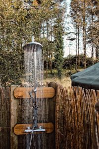 the outdoor heated shower at the Pengelly Retreat luxury yurt