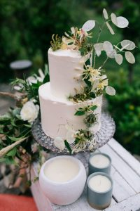 Wedding cake and candles in Cornwall